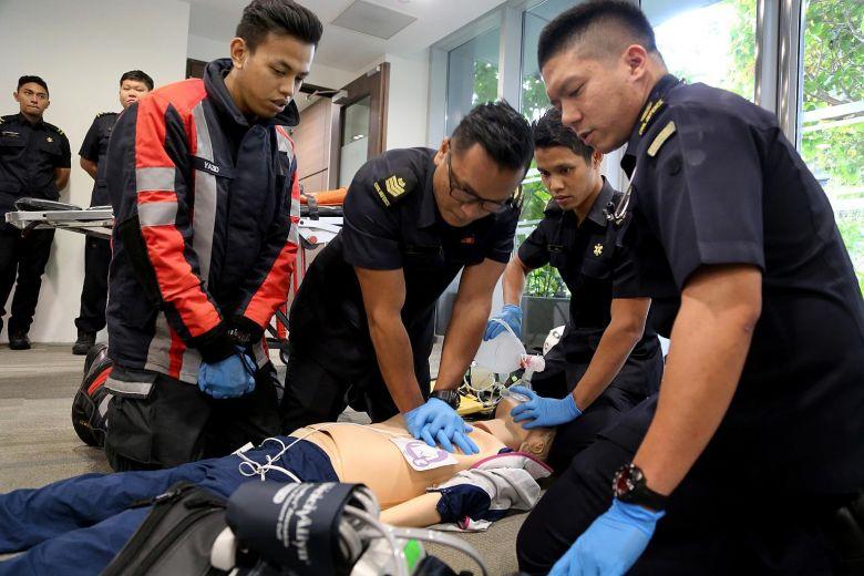 SCDF personnel rescuing victim of cardiac arrest